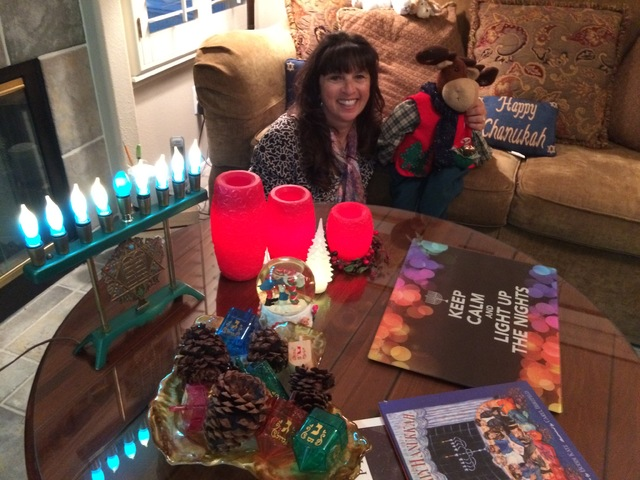 Tobie Buccieri shows off her mix of Hanukkah and Christmas decorations Dec. 7, 2016 in her Desert Shores home. She is Jewish. Her husband, Eddie, is Catholic.  (JAN HOGAN/View)