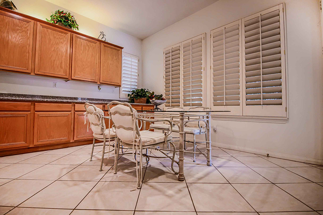 Real estate professional Gordon Miles remodeled this 1998 Las Vegas home. This is the kitchen before the $80,000 remodel.