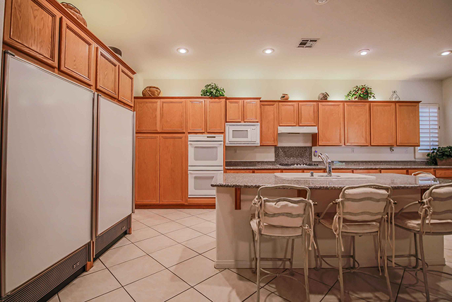 Real estate professional Gordon Miles remodeled this 1998 Las Vegas home. This is the kitchen after the remodel. (Courtesy)