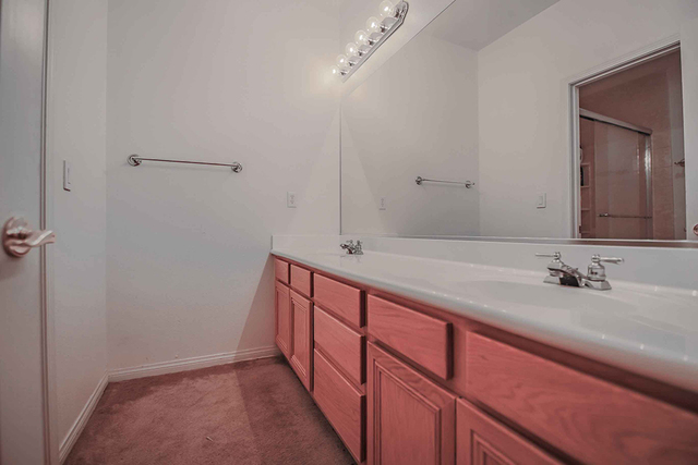 Real estate professional Gordon Miles remodeled this 1998 Las Vegas home. This is the bathroom before the remodel. (Courtesy)