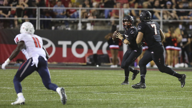 UNLV quarterback Dalton Sneed (18) looks to throw a pass during a football game against Fresno State at Sam Boyd Stadium in Las Vegas on Saturday, Oct. 1, 2016. (Miranda Alam/Las Vegas Review-Jour ...