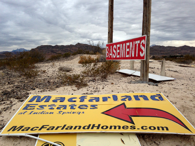 A damaged sign for the failed Macfarland Estates subdivision in Indian Springs is seen off U.S. 95 just east of the town on Dec. 21, 2016. Eli Segall/Las Vegas Review-Journal