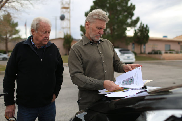 Steve Schneider, left, and Mason Harvey look at plans for their apartment complex in Indian Springs, Nev., on Wednesday, Dec. 21, 2016. Brett Le Blanc/Las Vegas Review-Journal Follow @bleblancphoto