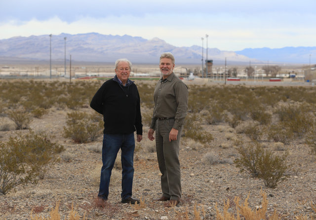 Steve Schneider, left, and Mason Harvey stand where their apartment complex will be built in Indian Springs, Nev., on Wednesday, Dec. 21, 2016. Brett Le Blanc/Las Vegas Review-Journal Follow @bleb ...