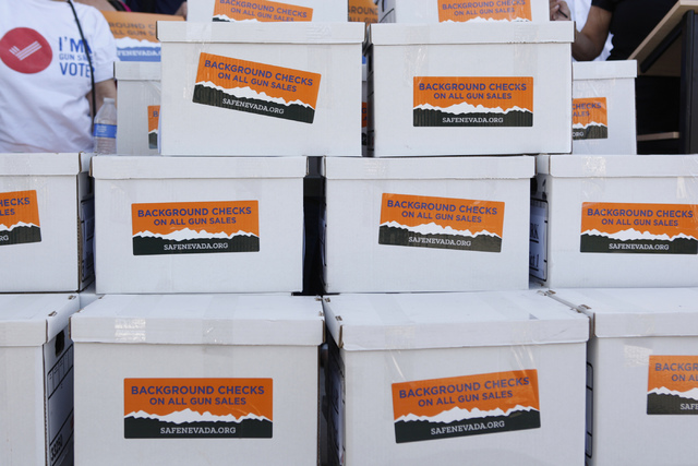 Boxes with a total of 246,674 signatures are seen outside of the Clark County Election Center in North Las Vegas where volunteers with Nevadans for Background Checks hosted a press conference befo ...