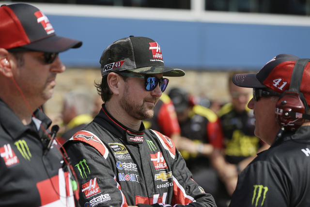 Driver Kurt Busch talks to a crew member after qualifying for the NASCAR Sprint Cup series auto race at Michigan International Speedway, Friday, June 10, 2016 in Brooklyn, Mich. (Carlos Osorio/AP)