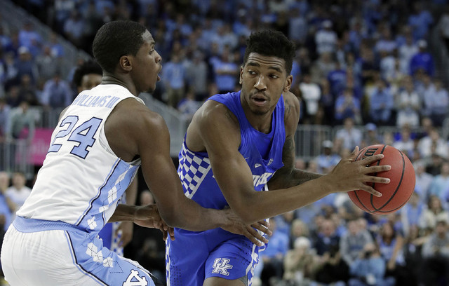 Kentucky's Malik Monk passes around North Carolina's Kenny Williams during the second half of an NCAA college basketball game Saturday, Dec. 17, 2016, in Las Vegas. Kentucky won 103-100. (John Loc ...