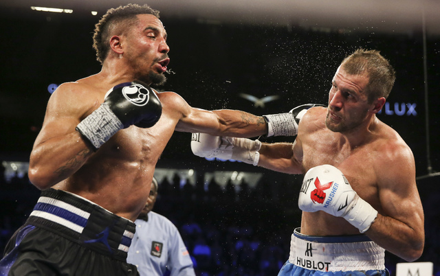 Andre Ward, left, hits Sergey Kovalev during their light heavyweight title boxing match at T-Mobile Arena in Las Vegas on Saturday, Nov. 19, 2016. Ward won in a unanimous decision. (Chase Stevens/ ...