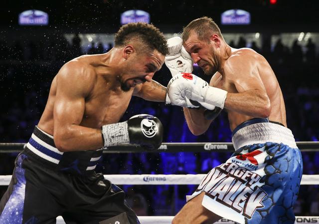 Andre Ward, left, and Sergey Kovalev trade punches during their light heavyweight title boxing match at T-Mobile Arena in Las Vegas on Saturday, Nov. 19, 2016. Ward won in a unanimous decision. (C ...