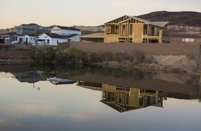 A home under construction reflects off a pond at Lake Las Vegas on Tuesday, Dec. 20, 2016. Jeff Scheid/Las Vegas Review-Journal Follow @jeffscheid
