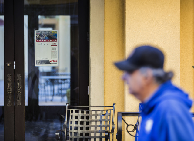 A man walks past a business space available for lease at MonteLago Village on Tuesday, Dec. 20, 2016. Lake Las Vegas' retail section is listed for sale at $10 million. Jeff Scheid/Las Vegas Review ...