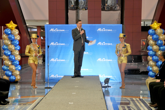Chris Jones, Chief Marketing Officer for McCarran International Airport, announces a fashion show to introduce new uniforms for the airport's Passenger Services Representatives on Thursday, Dec. ...