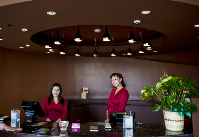 Britney Morales, left, Tiana Williams, concierge'  in the entry of the newly opened Eclipse Theaters that has a full bar, craft cocktails and intimate theatre sizes of about 40, 814 S. Third Stree ...