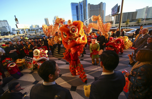 Members of the Lohan School of Shaolin perform as Lucky Dragon Chief Operating Officer David Jacoby, lower right, looks on during the grand opening of the hotel-casino in Las Vegas on Saturday, De ...