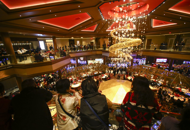 People take in the views during the grand opening of the Lucky Dragon hotel-casino in Las Vegas on Saturday, Dec. 3, 2016. (Chase Stevens/Las Vegas Review-Journal) @csstevensphoto