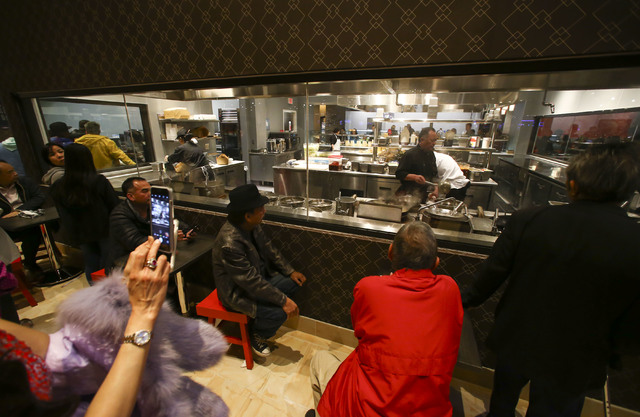 People look in at a restaurant during the grand opening of the Lucky Dragon hotel-casino in Las Vegas on Saturday, Dec. 3, 2016. (Chase Stevens/Las Vegas Review-Journal) @csstevensphoto