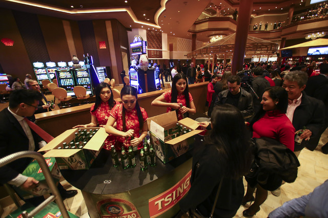 Beers are given out during the grand opening of the Lucky Dragon hotel-casino in Las Vegas on Saturday, Dec. 3, 2016. (Chase Stevens/Las Vegas Review-Journal) @csstevensphoto
