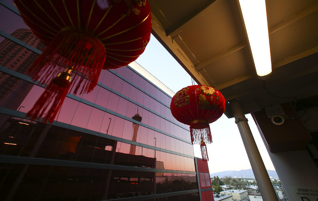 The Stratosphere hotel-casino is reflected in the exterior of the Lucky Dragon hotel-casino in Las Vegas on Saturday, Dec. 3, 2016. (Chase Stevens/Las Vegas Review-Journal) @csstevensphoto