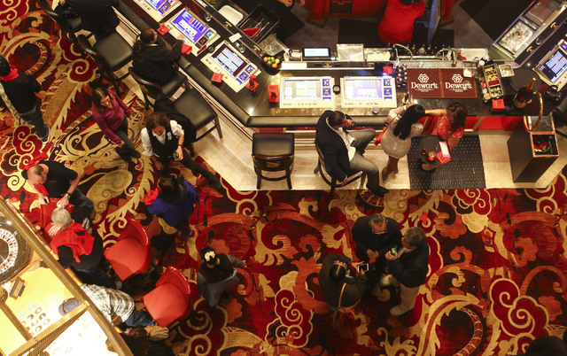 People mingle on the casino floor during the grand opening of the Lucky Dragon hotel-casino in Las Vegas on Saturday, Dec. 3, 2016. (Chase Stevens/Las Vegas Review-Journal) @csstevensphoto