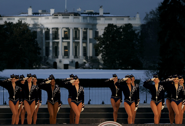 In this Wednesday, Jan. 19, 2005, file photo, the Rockettes perform during the Celebration of Freedom Concert on the Ellipse, with the White House in the background in Washington. (Chris Gardner/AP)
