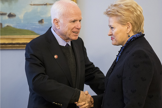 Lithuania's President Dalia Grybauskaite, right, welcomes U.S. Senator John McCain, R-Ariz. during a welcome ceremony in the Presidential palace in Vilnius, Lithuania, Thursday, Dec. 29, 2016. (AP ...