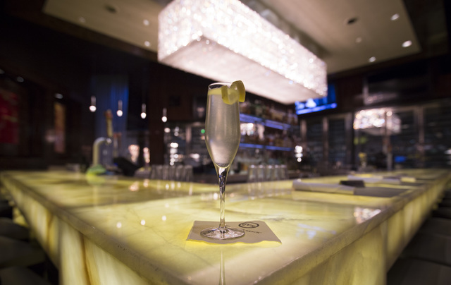 The French 75, a light and refreshing cocktail from Hanks Fine Steaks and Martinis, is made with lemon, sugar and champagne at Green Valley Ranch Resortin Henderson on Friday, Dec. 23, 2016. Brett ...