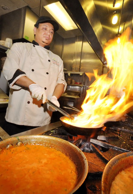 Chef Manoj Dhamala works on an Indian curry in the kitchen at the Mint Indian Bistro, 730 E. Flamingo Road in Las Vegas, Sunday, Nov. 13, 2011. (Bill Hughes/Las Vegas Review-Journal)
