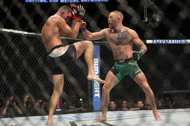 Nate Diaz, left, battles Conor McGregor in the welterweight bout during UFC 202 at T-Mobile Arena on Saturday, Aug. 20, 2016, in Las Vegas. McGregor won by majority decision. (Erik Verduzco/Las Ve ...