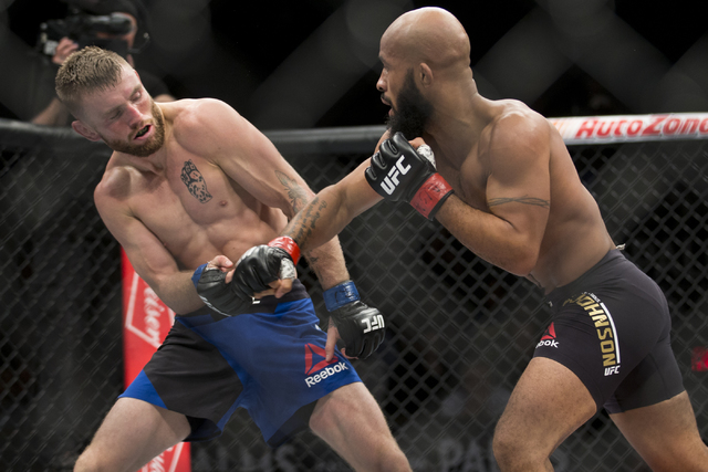 Timothy Elliot, left, battles Demetrious Johnson in The Ultimate Fighter 24 Finale flyweight title bout at the Palms hotel-casino Pearl Theater on Saturday, Dec. 3, 2016, in Las Vegas. Johnson won ...