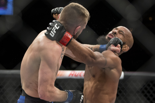 Timothy Elliot, left, connects a left punch against Demetrious Johnson in The Ultimate Fighter 24 Finale flyweight title bout at the Palms hotel-casino Pearl Theater on Saturday, Dec. 3, 2016, in  ...