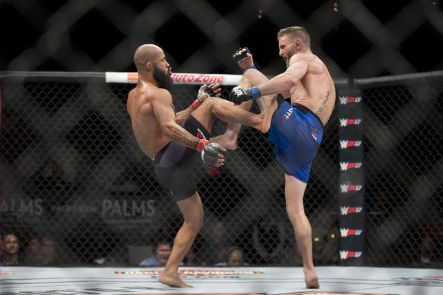 Demetrious Johnson, left, battles Timothy Elliot in The Ultimate Fighter 24 Finale flyweight title bout at the Palms hotel-casino Pearl Theater on Saturday, Dec. 3, 2016, in Las Vegas. Johnson won ...