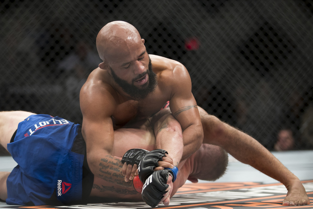 Demetrious Johnson, top, pulls the arm of Timothy Elliot in The Ultimate Fighter 24 Finale flyweight title bout at the Palms hotel-casino Pearl Theater on Saturday, Dec. 3, 2016, in Las Vegas. Joh ...