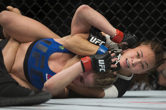 Michelle Waterson, right, submits Paige VanZant during the first round in the UFC Fight Night women's strawweight bout at the Golden 1 Center on Saturday, Dec. 17, 2016, in Sacramento, Calif. Wa ...