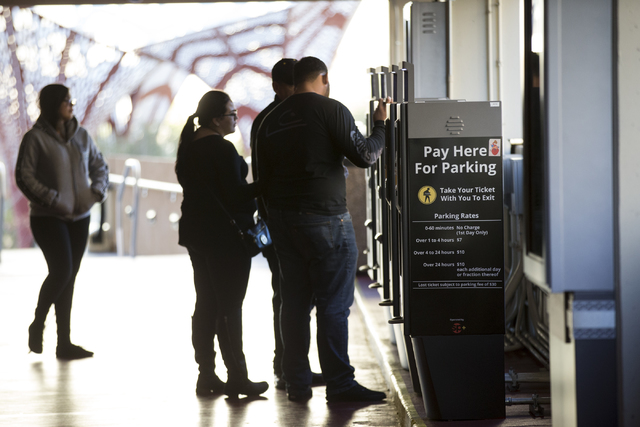 People pay for their parking at New York-New York hotel-casino parking lot on Wednesday, Dec. 28, 2016, in Las Vegas. Erik Verduzco/Las Vegas Review-Journal Follow @Erik_Verduzco