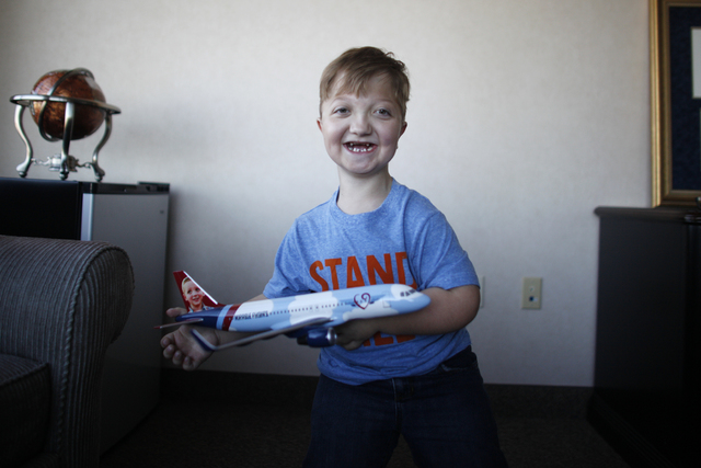 Levi Krystosek, 10, is pictured at the offices of Miracle Flights on Monday, Dec. 19, 2016, in Las Vegas. Levi, who has a rare form of dwarfism, took the 100,000th flight provided by Miracle Fligh ...