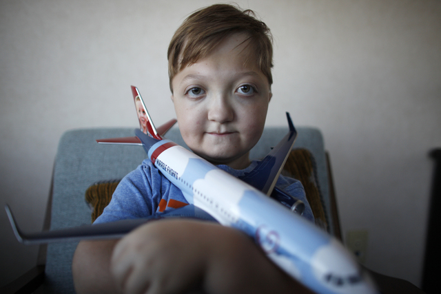 Levi Krystosek, 10, is pictured at the offices of Miracle Flights on Monday, Dec. 19, 2016, in Las Vegas. Levi has a rare form of dwarfism. He took the 100,000th flight provided by Miracle Flights ...