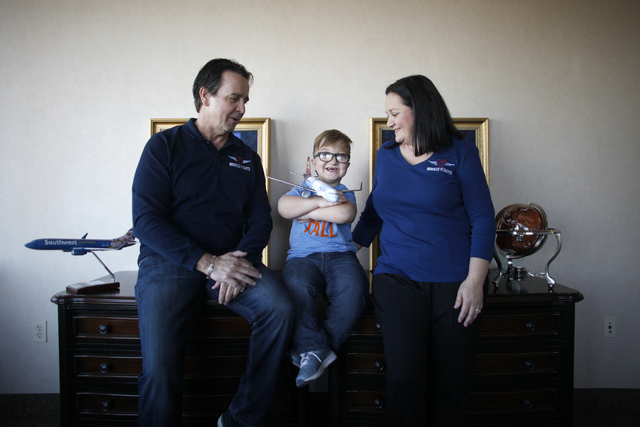 Miracle Flights CEO Mark Brown, from left, Levi Krystosek, 10, and Levi's mom Dona Krystosek at the offices of Miracle Flights on Monday, Dec. 19, 2016, in Las Vegas. (Rachel Aston/Las Vegas Revie ...