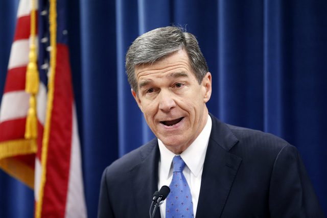North Carolina's Governor-elect Roy Cooper holds a press conference to criticize efforts by Republicans to cut the power of the governor's office during the special session of the General Assembly ...