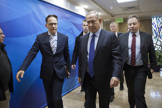 Israeli Prime Minister Benjamin Netanyahu, second right, arrives for a weekly cabinet meeting in Jerusalem, Sunday, Dec. 25, 2016. (Dan Balilty/AP)