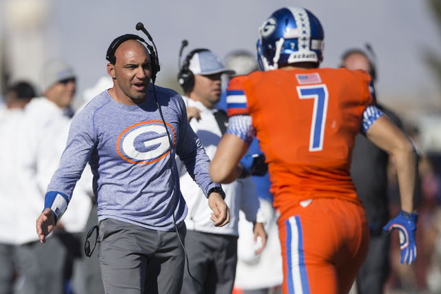 Bishop Gorman's head football coach Kenny Sanchez reaches his hand for Biaggio Walsh (7) after his touchdown against Liberty in the Class 4A state football championship game at Sam Boyd at Sam Boy ...