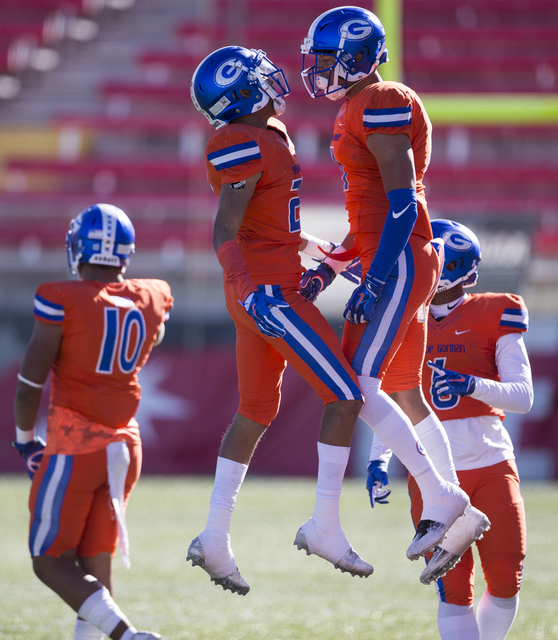 Bishop Gorman Pierson Mook (20), left, celebrates his interception with Damuzhea Bolden in the Class 4A state football championship game at Sam Boyd Stadium on Saturday, Dec. 3, 2016, in Las Vegas ...