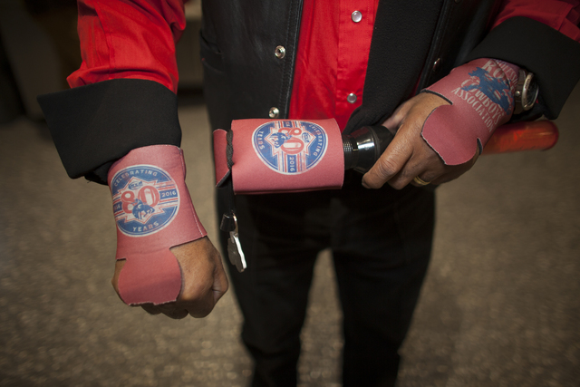 Huntington Banes shows off his beer koozies at the National Finals Rodeo at Thomas & Mack Center on Sunday, Dec. 4, 2016, in Las Vegas. (Rachel Aston/Las Vegas Review-Journal) @rookie__rae