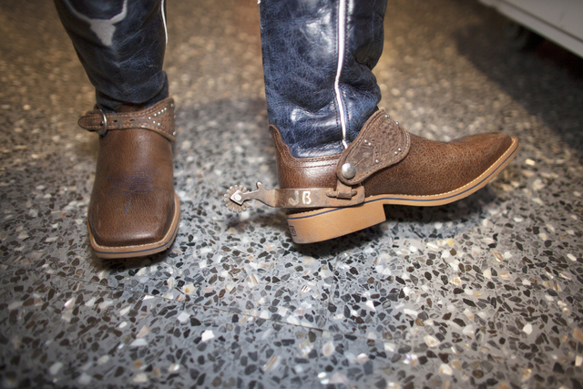 Jake Beutler shows off his cowboy boots with his initials on them at the National Finals Rodeo at Thomas & Mack Center on Sunday, Dec. 4, 2016, in Las Vegas. (Rachel Aston/Las Vegas Review-Jou ...