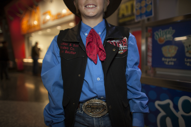Jake Beutler shows off his vest and shirt combo at the National Finals Rodeo at Thomas & Mack Center on Sunday, Dec. 4, 2016, in Las Vegas. (Rachel Aston/Las Vegas Review-Journal) @rookie__rae