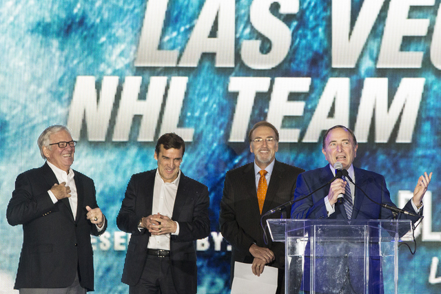NHL commissioner Gary Bettman, right, speaks during a ceremony to unveil the Las Vegas' NHL expansion franchise's official team nickname, logos and colors on Tuesday, Nov. 22, 2016, at Toshiba Pla ...
