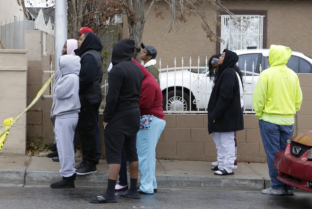 Residents watch as police are investigating an arson what they say is a ҳuspicious deathӠthat might be linked to the arson on the 300 block of Princess Avenue in North Las Vegas on Thursday, Dec ...