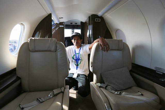 Tommy Suell, chief pilot for Steelman Aviation Charter, poses for a photo in a Pilatus PC-12 owned by Steelman during an open house at the North Las Vegas Airport on Saturday, Dec. 10, 2016. Brett ...