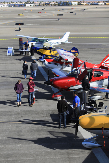 People tour aircraft on the tarmac of North Las Vegas Airport during an open house on Saturday, Dec. 10, 2016. Brett Le Blanc/Las Vegas Review-Journal Follow @bleblancphoto