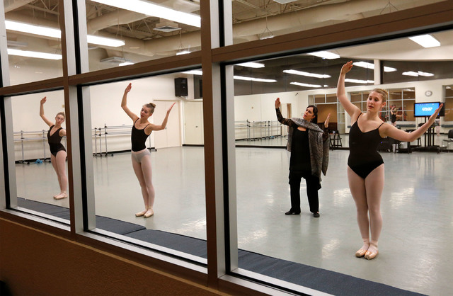 "Natalie Browne, the Academy of Nevada Ballet Theatre student, from right, performs in the role of  Soldier Doll during a ""Nutcracker"" rehearsal with other students Gillian Croshaw and Chandler Orn ..."