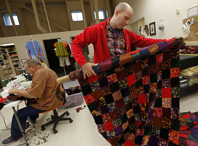 Nevada Ballet Theatre Ballet wardrobe manager Chris Larson shows a roll of cloth while making the Nutcracker costumes at NBT in Las Vegas, Wednesday, Nov. 30, 2016. (Chitose Suzuki/Las Vegas Revie ...